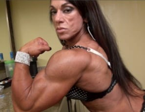 Tattooed female bodybuilder Carla shows that she's a professional, because she can pose in a kitchen and make it look hot, showing off her ripped abs, vascular biceps, muscular pecs, glutes, legs, and calves, and muscle control, all in sexy panties.