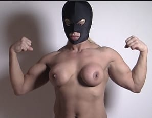 Slave Lauren is posing for you, showing off her muscular pecs, legs, glutes and biceps, masturbating her big clit ,  and playing with her ass while you watch  close up.