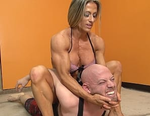 Professional female bodybuilder Maria G 's fitness client thinks he's getting a yoga session. Instead, he gets wrestling and scissoring from the ripped, vascular, tattooed muscles of he,pecs, legs, glutes and biceps. Namaste, dude.