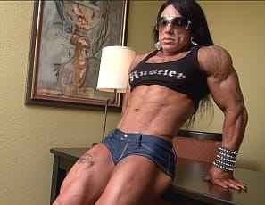 Tattooed female bodybuilder Carla poses for you, showing you how vascular her biceps, legs and calves are , how muscular her pecs and glutes are, and how ripped her abs are.