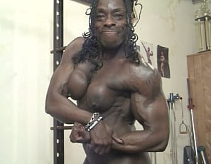 In the gym, professional female bodybuilder Roxanne Edwards shows you the right way to do a chin-up and a one-arm dumbbell row. She's naked so you can see every ripped ebony muscle as she poses to show you her vascular biceps, legs, glutes and abs.