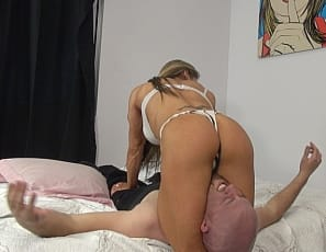 Professional female bodybuilder Maria G gets wrestles a lazy man in the bedroom, smothering and scissoring him with her muscular legs and glutes, using her vascular biceps, ripped abs, and powerful pecs to overpower him. All he can do is try to sniff her panties. Watch her win in close-up.