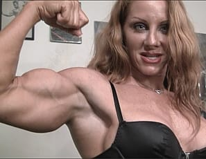 Red headed muscle goddess IronFire poses and flexes her huge muscles in the gym just for you. What could be better than her sexy bulging biceps, her hard abs, and her long strong legs? How about when she gives you just a a peek at her pretty pussy? amazing!