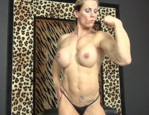 Tattooed female bodybuilder Sophie poses for you in panties, flexing her big, vascular biceps and showing you her ripped abs, powerful pecs, and muscular legs and glutes.