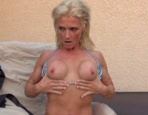 Female muscle porn star Mandy Foxx shows off the muscles of her pecs. legs, glutes and abs as she poses for a friend, shows him her ass, and penetrates herself with a vibrator as she masturbates with the toy. What does the Foxx say? She lets her pussy do the talking.