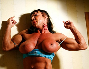 When Carmella and Deb get together you never know what to expect. There will be plenty of female muscle, huge biceps, muscle worship, posing, flexing, and big muscle pecs. There's so much muscle between these two sexy lesbians that it might be a bit intimidating - but you'll suffer through it, right?