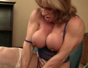 Female bodybuilder Wild Kat is more than the bachelor party attendees expected. She's humiliating them, forcing them to suck her big clit and worship her muscles, and giving them hand jobs, bicep jobs, calf jobs, muscle fucking and CBT as she uses her powerful pecs, legs and glutes. Watch the muscle porn sex close up.