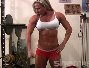 Female muscle bodybuilder Darkside Milinda sure is a show off, and who could blame her? Watch as she poses and flexes her powerful muscles and exposes her bulging biceps, amazing abs, glorious glutes, and you even get a peek at her pretty pussy. How could you not watch this nude female bodybuilder?