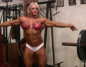 Bodybuilder Lisa Cross brings it all to the gym. Working out and getting nude in the gym, she shows off her powerful pecs, enormous biceps and ripped abs as well as her big, vascular legs and tight glutes. She's so excited by all the posing that she starts to masturbate her big clit, in close-up. Are you excited? Check!