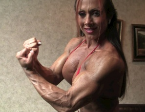 Female bodybuilder Monica Martin gives you a virtual session, posing to show you her big, vascular biceps, legs and calves, her gorgeous glutes in tiny panties, her tattooed, ripped abs, and her muscle control of her powerful pecs.