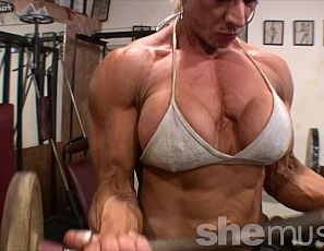 Muscular Nicole Savage realizes that she's not everyones cup of tea. Some prefer fitness girls to female muscle women with huge biceps, massive legs, and powerful vascular forearms. Nicole is a female bodybuilder, she works hard to get huge and she doesn't care if you don't like it! She knows there are just as many, if not more, who bow down and worship her amazing strength.