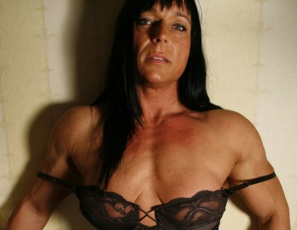 Irene Anderson is a professional female bodybuilder, and she knows what you want to see. You want to see lots of ripped, vascular muscle. Check. You want to see powerful pecs, biceps and triceps. Got it. You want to see posing in the bedroom in nothing but panties and high-heeled shoes that make the most of her glutes, legs and calves. Done. The pro knows.