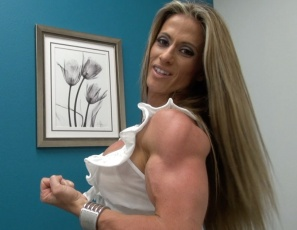 Tattooed professional female bodybuilder Maria G shows you how muscular and vascular her biceps, legs, pecs, glutes and calves are, and how ripped her abs are, as she poses for you in panties and high-heeled shoes.