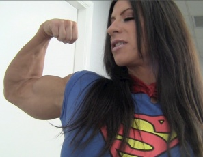 Angela Salvagno is more than just a ripped female bodybuilder posing with powerful pecs and big, vascular biceps. She's a superheroine, so when her boyfriend cheats on her, she punishes him, belly punching him, scissoring him with her powerful legs and glutes, indulging in some CBT, then giving him a super hand job.