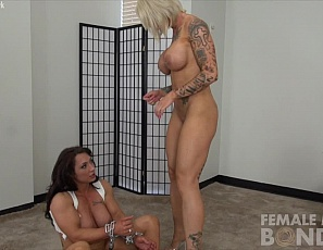 Female bodybuilder BrandiMae is finally free of the chains tattooed, naked fem domme Dani Andrews put her in. BrandiMae is now free to flex the ripped, vascular muscles of her pecs, legs, glutes, biceps and abs. Of course Dani isn't satisfied until she fucks her slave with a vibrator, making her cum.
