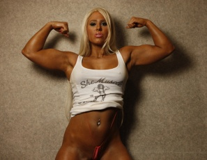 We have a theory that muscle girls look their best when they're wearing the least. Megan Avalon proves it as she poses in nothing but a V-string and high-heeled shoes, showing off her big biceps, powerful pecs, awesome abs, luscious legs, gorgeous glutes, curvaceous calves. Then she gives you a close-up look at her pretty kitty. Q.E.D.