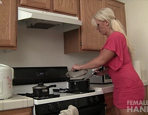 Female muscle pornstar Alura Jenson gives her boyfriend a handjob in the kitchen and he's loving it. She strokes his long cock and shows him her powerful, massive pecs.