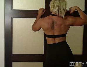 Muscular Milinda loves showing her darkside, and you'll be glad she does. She strips down to nothing showing us her amazing physique: full pecs, ripped abs and arms, and those long muscular legs. The real fun begins when she gets her glass toy out and fucks herself silly. This self-shot video is a keeper!