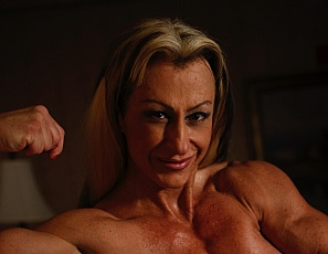 Muscular Gina Jones loves showing off her powerful body. From the peaks of her big biceps, to the bulge of muscle in her calves, Gina is one power packed woman. In fact, seeing this set of pictures made us think that Gina has power to spare.