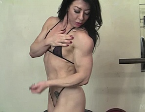 Super sexy muscular porn star Carmin Blue loves working out her clit in the gym. Just like her big biceps, powerful pecs and quads, the more she works it the larger it gets. It also makes her pussy extremely wet and ready for what comes next!