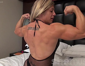 Powerful female bodybuilder Extreme Thule is posing and flexing in a sheer/mesh outfit - at least for a while. Showing off her sext glutes, muscular back and big biceps puts Thule in a playful mood and soon she is showing off wearing nothing but her tiny little panties. Lovely.