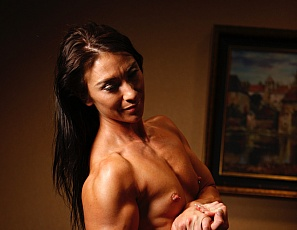 Jenna is totally nude in this photo set, and we can we say - she is a true work of art. From her perky pecs, to her ripped abs and vascular biceps and strong quads Jenna really has it all. Some people go to museums or art galleries to experience fine art. We think that all you need do is admire Jenna.