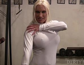 In the gym, muscular porn star Ashlee Chambers, all in skin-tight white, shows off her massive physique, ripped abs, glutes, legs and biceps for your pleasure. And hers.