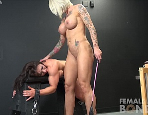 Female bodybuilder BrandiMae can't escape the clutches of Dani Andrews. She has to obey her tattooed mistress, who has bound her up, worships her muscles and pecs, vascular biceps, legs, and ripped abs, and masturbates Brandi's pussy with a vibrator while you watch.