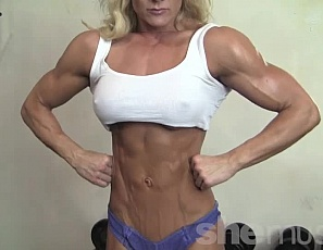 Female bodybuilder Carmen's posing and working out in the gym in panties to show you how strong, vascular and ripped the mature muscles of her pecs, legs, glutes, biceps and abs are. You'll like her hack squats, too.