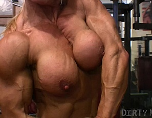 Nicole Savage is working her savagely hard-muscled body in the gym, touching her big pierced clit and showing off her ripped abs, strong legs and vascularity. This one Savage we are sure you'd like to get to know.