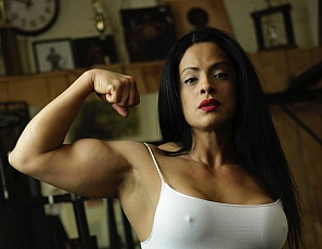 Sexy female bodybuilder Jane Santos is featured in a variety of outfits - all showing off her incredible physique. Jane loves showing off her big biceps and powerful legs. She works hard in the gym to stay strong and we're sure you'll agree that the results are worth it!