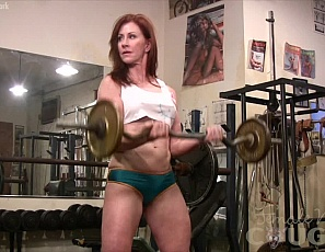 Female bodybuilder Vanna enjoys the feeling of metal on her body as she rests the bar on her pecs in between presses at the gym, and likes to reward herself by using the end of the bar for its own special cooling and stroking properties. She poses to demonstrate, showing off her biceps, legs and glutes.