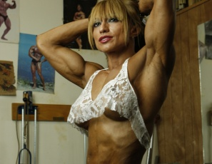 If you like women vascular and ripped, you'll love looking at professional female bodybuilder Karina as she poses and works out in the gym in black panties. Every muscle is super-defined, from her biceps to her pecs to her abs to her legs, glutes and calves. There's ripped, and then there's ultra-ripped Karina.