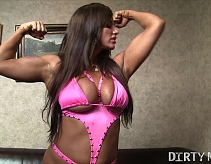Female muscle pornstar Nikki Jackson invites us into her bedroom and immediately takes out her enormous tits and tells us what she's going to be doing to herself. And then gets two it. Watch as Nikki fuck her asshole and her pussy with two vibrators. She really gets off when she slides three of her fingers into her pussy. This is a good watch!