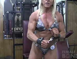 Super ripped female bodybuilder Lacey is in trouble again. Seems this time she kept messing up her posing. So her trainer bound her up and decided to teach her a lesson. He must have forgotten how much Lacey loves to be restrained, because by the end of this video she is on the ground, fingers all over her big clit and wet pussy.