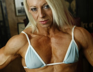 Professional female bodybuilder Nathalie Falk has a perfect six-pack. It's not the kind you drink from – it's made of muscular, ripped, vascular, tattooed abs, and when she's posing in the gym in nothing but panties, you can't stop looking at it. Her pecs, legs, glutes, calves and  biceps are pretty perfect, too.