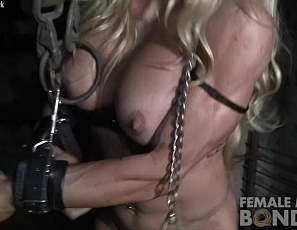 Professional female bodybuilder Jill Jaxen may have ripped abs, vascular biceps, and muscular pecs, legs, and glutes, but they're not getting her out of her chains in a dungeon.