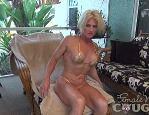 Mature, flexible female muscle porn star Mandy Foxx relaxes by taking off her panties, masturbating,  and penetrating herself with a toy while you enjoy looking at her vascular biceps, sexy pecs, and tight abs.