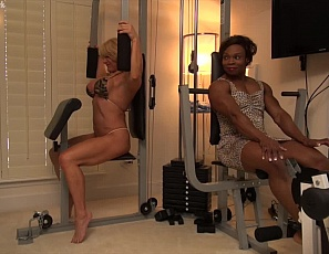 Mature female bodybuilder Wild Kat and ebony female muscle porn star Nadia are working their vascular biceps,, glutes, ripped abs and pecs in the gym and posing. Nadia whips out a big strap-on dildo, Kat sucks on the toy, then Nadia teases Kat's big clit with it and gets ready to penetrate her while you watch the hot muscle sex.