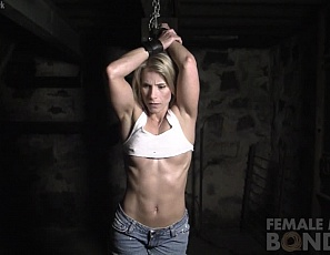 Claire finds herself captive in a dungeon and chained up by the wrists. She pleads to be released and says,