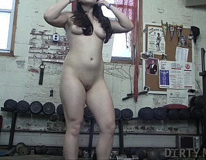 Danica Dane is back in the gym squatting and working out her legs and glutes. Of course Danica being the naughty girls she is has brought her double ended stainless steel dildo to give her pussy a masturbation workout.