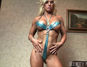 Sexy Megan loves showing off her amazing body. Sometimes when she starts rubbing herself she gets so turned on, and who could blame her? Those amazing pecs and sexy ripped abs are enough to turn anyone on. Once she starts rubbing her