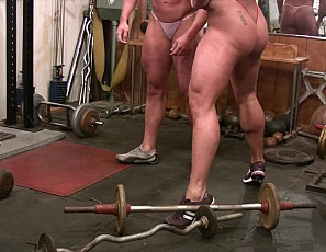 Amber Steel and a topless Delphine are lifting and posing in the gym, working their pecs and legs spotting each other on the inline bench press - you'll like our seat-level camera angle and the girl/girl closeness. These two certainly admire each others muscles!