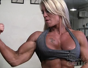 Super sexy muscle cougar Ginger Martin is fit, ripped, and hot! She certainly gets a kick out of showing off her biceps, ripped abs, and tattooed pecs. Ginger is like fine wine, she gets better with time. Don't you agree?