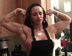 Female bodybuilder Nikki Jackson, wearing stockings, high-heeled shoes and an apron, is making herself protein pancakes and smoking a cigarette while she poses and flexes her muscular biceps, legs and glutes. She's ready for muscle worship, and as she waits, she spanks her pussy with the spatula. She's as hot as her hotcakes.