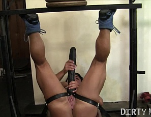 Tattooed female bodybuilder Whitney is in the gym, and strapped in on the leg press so she can use a huge strap-on toy to suck her own dick while she plays with her pussy and you enjoy her muscular pecs, legs, glutes, and biceps and watch her moan close up.