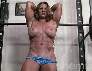 Sexy mature redhead IronFire poses and flexes just for you. She loves to show off her biceps and abs (not mention her pec bouncing muscle control!) to everyone who cares to watch. Are you watching? We bet you are! And you love what you see!