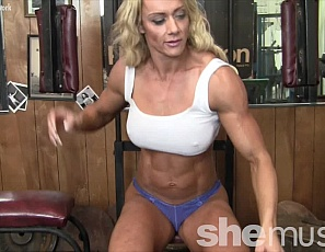 Female bodybuilder Carmen works her the muscles of her vascular biceps, triceps, pecs, legs, glutes, and calves in the gym, then poses to show you how good her ripped abs look. She's working hard, and you're probably looking hard.