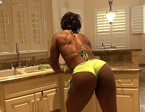 Female bodybuilder and muscle porn star Nadia is posing for you in the kitchen, taking off her panties so you can see the naked ebony muscles of her legs, glutes, abs and biceps, and playing with her ass and masturbatiing her big pink clit while you watch it throb in close-up.