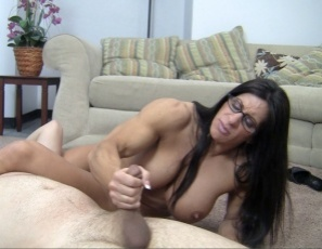 Female bodybuilder Angela Salvagno humiliates her client, scissoring him with her muscular legs, glutes, and calves, belly punching him, posing to show him her powerful pecs, vascular biceps, tight abs and big clit, insisting on muscle worship, and giving him a hand job and CBT to help him get bigger. Would you be tough enough for Angela?